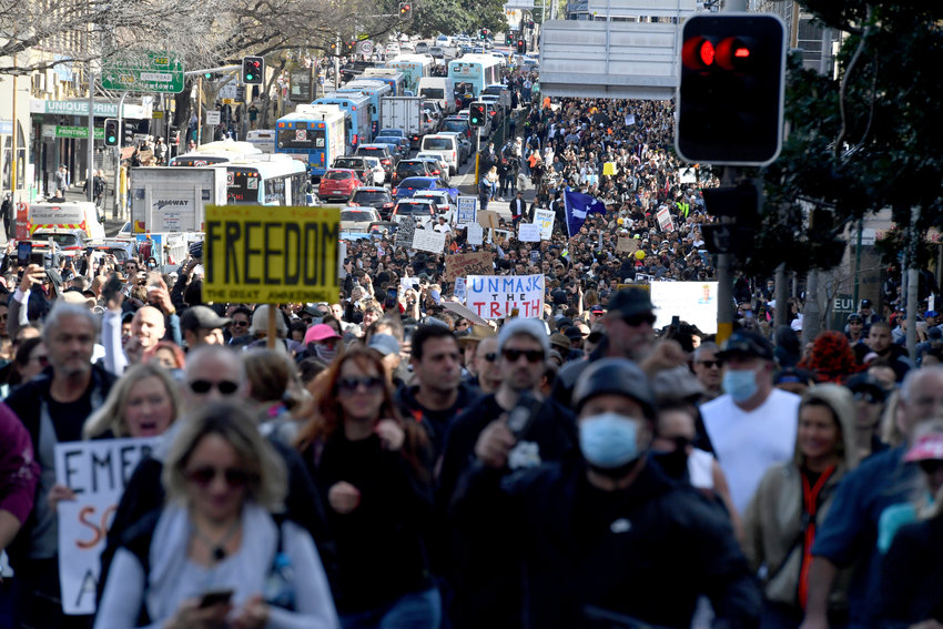 Protesters march through the streets during a ÅeWorld Wide Rally For FreedomÅf anti-lockdown rally in Sydney, Saturday, July 24, 2021. (Mick Tsikas/AAP Image via AP)