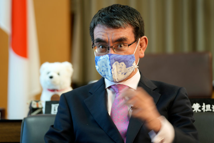 Japanese Vaccine Minister Taro Kono wearing a protective mask speaks during an interview with The Associated Press Wednesday, July 28, 2021, in Tokyo. (AP Photo/Eugene Hoshiko)