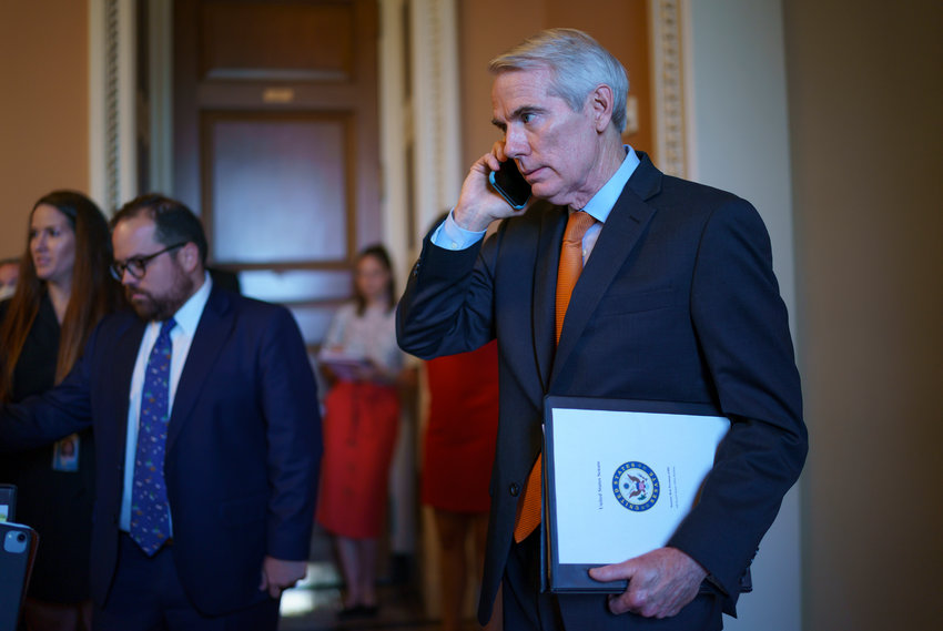 Sen. Rob Portman, R-Ohio, the lead GOP negotiator on the infrastructure talks, emerges from the office of Senate Republican leader Mitch McConnell to announce he has reached a $1 trillion infrastructure bill with Democrats and is ready to vote to take up the bill, at the Capitol in Washington, Wednesday, July 28, 2021. (AP Photo/J. Scott Applewhite) .