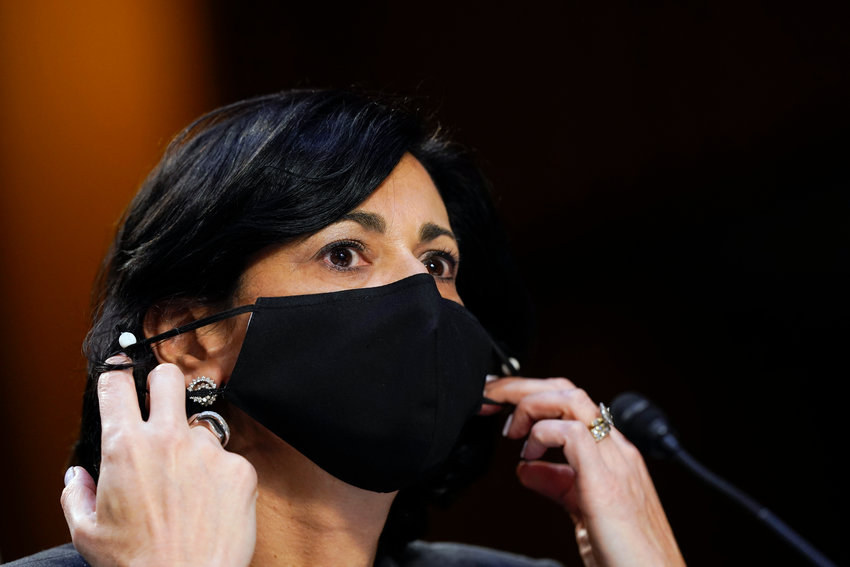 Dr. Rochelle Walensky, director of the adjusts her face mask during a Senate Health, Education, Labor and Pensions Committee hearing on the federal coronavirus response on Capitol Hill in Washington, Thursday, March 18, 2021. (AP Photo/Susan Walsh, Pool)