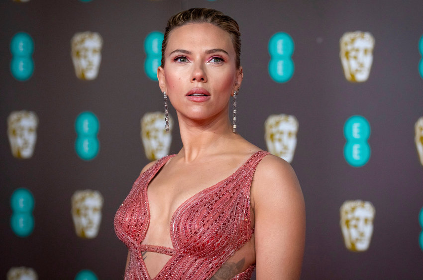 FILE - Scarlett Johansson arrives at the Bafta Film Awards, in central London, Feb. 2 2020. (Photo by Vianney Le Caer/Invision/AP, File)