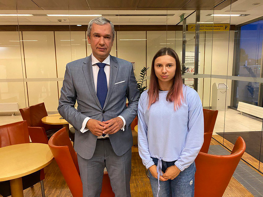 In this image taken on Wednesday Aug. 4, 2021 and provided by the National Anti-crisis Management, Belarusian Olympic sprinter Krystsina Tsimanouskaya, right, who seeks foreign refuge from Minsk authorities, poses for a photo with top Belarusian dissident in Poland, Pavel Latushko, left, shortly after her arrival at the Frederic Chopin Airport in Warsaw, Poland. Fearing for her safety at home after criticizing her coaches on social media, Tsimanouskaya flew from Tokyo to Warsaw with a stopover in Vienna. Poland has offered her and her husband humanitarian visas. (National Anti-crisis Management via AP)