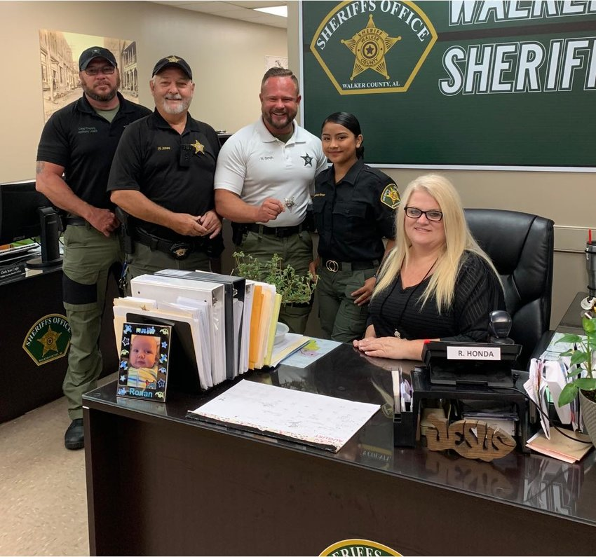 Melissa Perez, 14, spent some time working in the office at the Walker County Sheriff's Office after joining the Explorer Program two weeks ago. She is pictured with Chief Deputy Anthony Leach, solid waste officer Wayne Jones, Sheriff Nick Smith and administrative clerk Rhonda Guthrie.