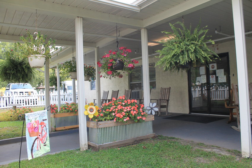 Hanging baskets and other flowers now make the front entrance of Walker Rehabilitation Center seem more welcoming to visitors, most of whom will not make it past the porch because of COVID restrictions.