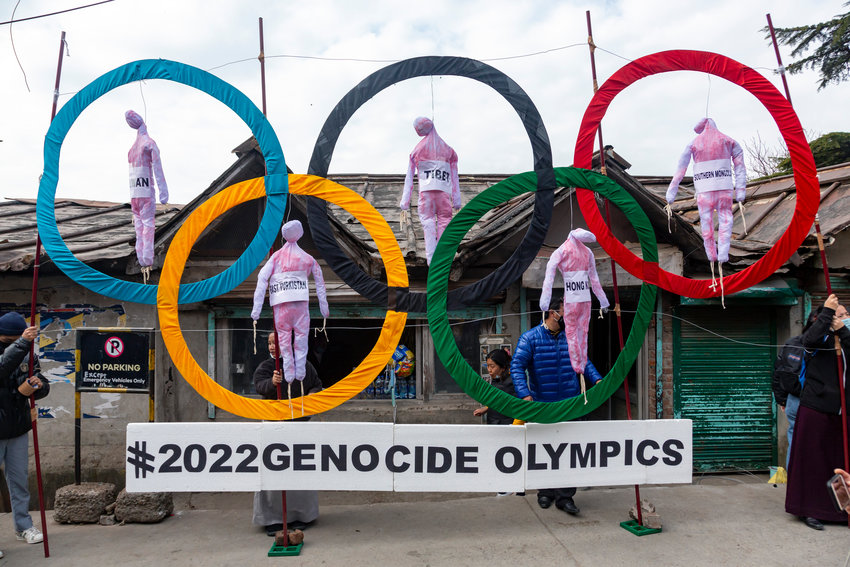 Exile Tibetans use the Olympic Rings as a prop as they hold a street protest against the holding of 2022 Winter Olympics in Beijing in Dharmsala, India, Wednesday, Feb. 3, 2021. Five effigies represent Taiwan, Tibet, Hong Kong, Inner Mongolia and the region ethnic Uighurs call 'East Turkestan', under Chinese control. (AP Photo/Ashwini Bhatia)