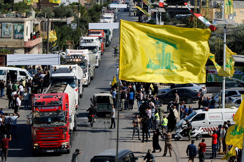 A convoy of tanker trucks carrying Iranian diesel crossed the border from Syria into Lebanon, arrive at the eastern town of el-Ain, Lebanon, Thursday, Sept. 16, 2021. The delivery, organized by the Iranian-backed Hezbollah group, violates U.S. sanctions imposed on Tehran after former President Donald Trump pulled America out of a nuclear deal between Iran and world powers three years ago. (AP Photo/Bilal Hussein)