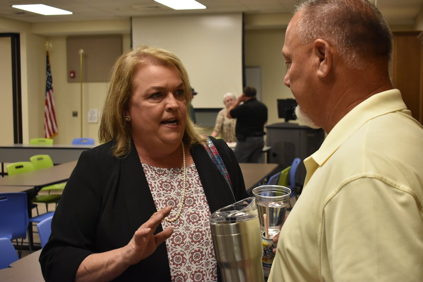 State Rep. Connie Rowe, R-Jasper, talks with Coroner Joey Vick after Tuesday's Walker County Republican Party meeting, where she announced she will not run for re-election.