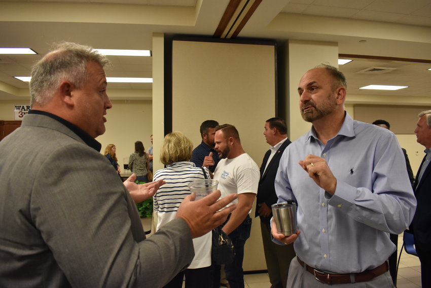 Dr. Dennis Willingham, right, superintendent of the Walker County School System, speaks with Parrish Elementary/Middle School Principal Thomas Kyzer after the Sept. 14 Walker County Republican Party meeting. Both men said that night they would run for superintendent in 2022.