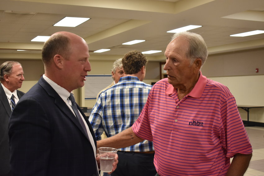 Lt. Gov. Will Ainsworth, left, who is running for re-election, and former state Sen. Charles Bishop speak after the Sept. 14 Walker County Republican Party meeting.