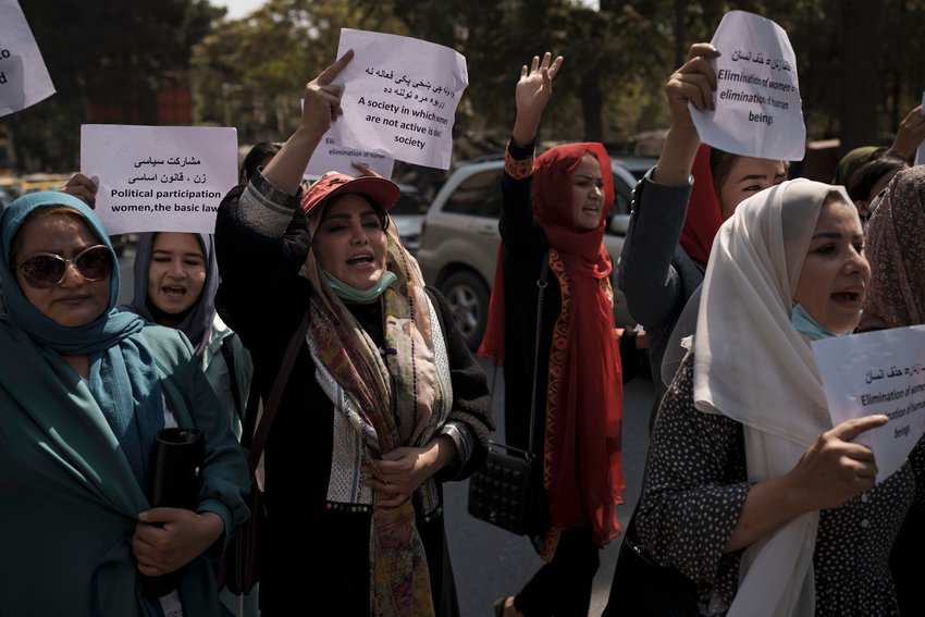 Women march to demand their rights under the Taliban rule during a demonstration near the former Women's Affairs Ministry building in Kabul, Afghanistan, Sunday, Sept. 19, 2021. (AP Photo) ..