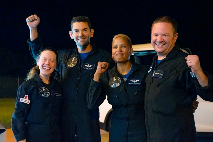 In this image released by Inspiration4, passengers aboard a SpaceX capsule, from left to right, Hayley Arceneaux, Jared Isaacman,  Sian Proctor and Chris Sembroski pose after the capsule was recovered following its splashdown in the Atlantic off the Florida coast, Saturday, Sept. 18, 2021. The all-amateur crew was the first to circle the world without a professional astronaut.  (John Kraus/Inspiration4 via AP)