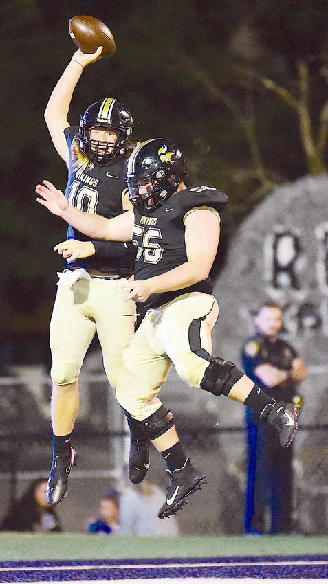 Jasper's Spencer Rosenfeld (10) celebrates with Colin Langley (56) following Rosenfeld's 57-yard touchdown run against Demopolis on Friday night. Rosenfeld rushed for two touchdowns and caught a touchdown pass in Jasper's 33-28 win.