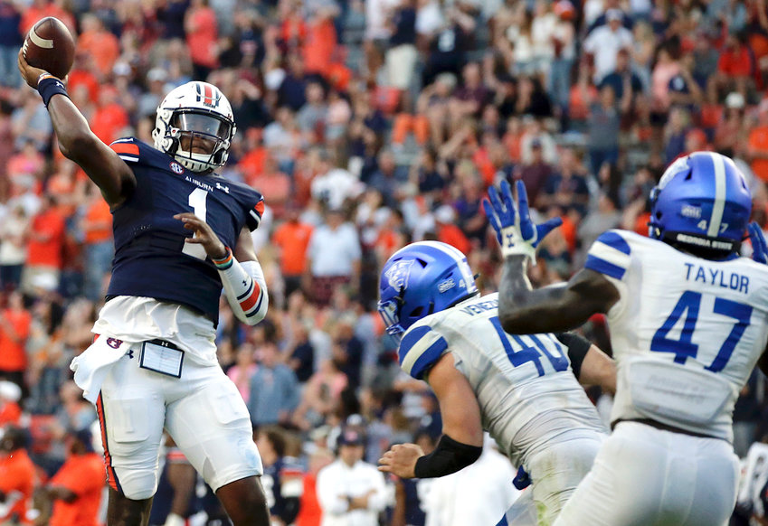 Auburn quarterback TJ Finley (1) throws a pass for a touchdown to take the lead over Georgia State in  the final minute of the second half of an NCAA football game Saturday in Auburn.
