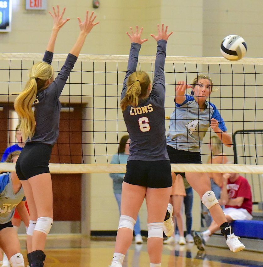 Curry's Alayna Key hits the ball past two Haleyville defenders during a match on Tuesday. Curry hosts the county tournament on Thursday and Saturday.