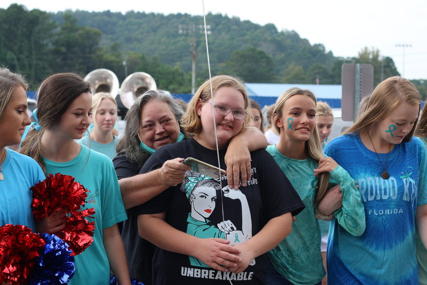 Senior Katelyn Dill is embraced by Cordova High students on Thursday, her final day of classes before beginning treatments for stage 3 ovarian cancer.