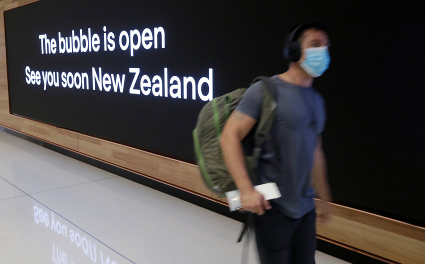 FILE - In this April 19, 2021, file photo a passenger travels through Sydney Airport, in Sydney, Australia. International tourists won't be welcomed back to Australia until next year, with the return of skilled migrants and students given higher priority, the prime minister said on Tuesday, Oct. 5, 2021. (AP Photo/Rick Rycroft, File)