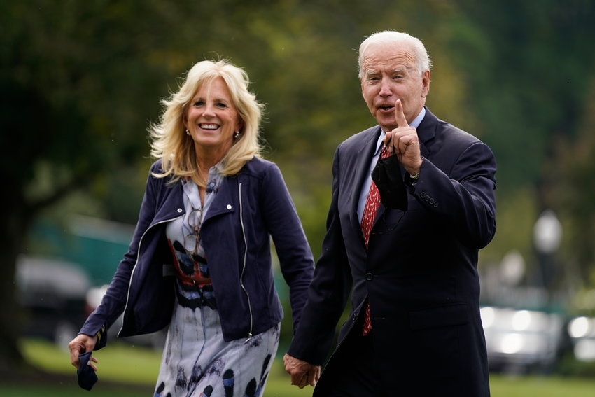 President Joe Biden and first lady Jill Biden arrive on the South Lawn of the White House after spending the weekend in Wilmington, Del., Monday, Oct. 4, 2021, in Washington. (AP Photo/Evan Vucci)