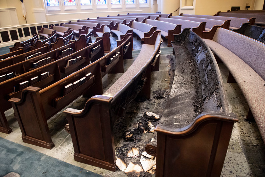 Fire damaged pews in the main sanctuary at First Baptist Church in downtown Montgomery, Ala., on Thursday, Sept. 30, 2021.