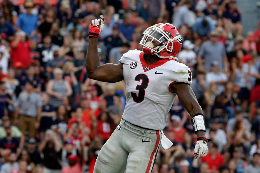 Georgia running back Zamir White (3) celebrates after a touchdown against Auburn during the second half of an NCAA college football game Saturday, Oct. 9, 2021, in Auburn, Ala. (AP Photo/Butch Dill)