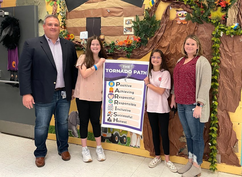 """Parrish Elementary/Middle School is busy implementing the Whole Child initiative at the school, which includes using """"The Tornado Path"""" daily. Pictured are Principal Dr. Thomas Kyzer, students Ansley Miller and Loretta Brenzek, and teacher Eleni Morrow."""
