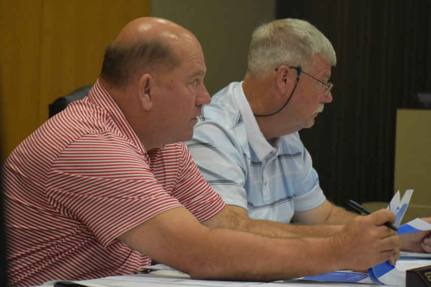 District 2 Walker County Commissioner Jeff Burrough, left, and District 3 Commissioner Jim Borden listen during an Oct. 12 work session on premium pay and a new pay schedule for employees.