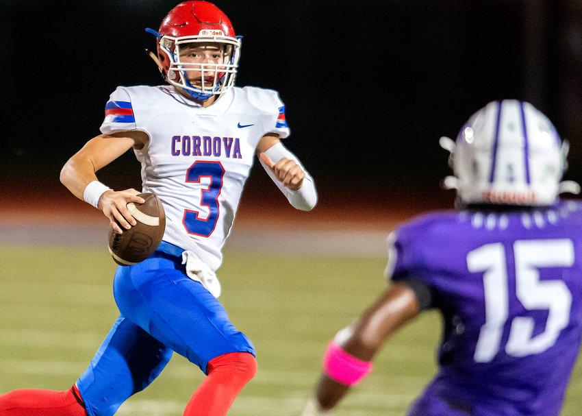 Cordova's Cody Headrick (3) eyes Parker's Courtland Watkins (15) during their game on Thursday night. Parker won 63-13.