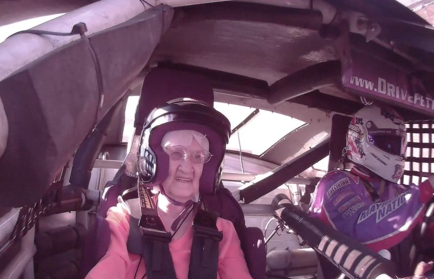 Gloria Vaughn smiles as she drives around Talladega Superspeedway at 170 miles per hour. The driving experience was a gift from her granddaughter for her 90th birthday.