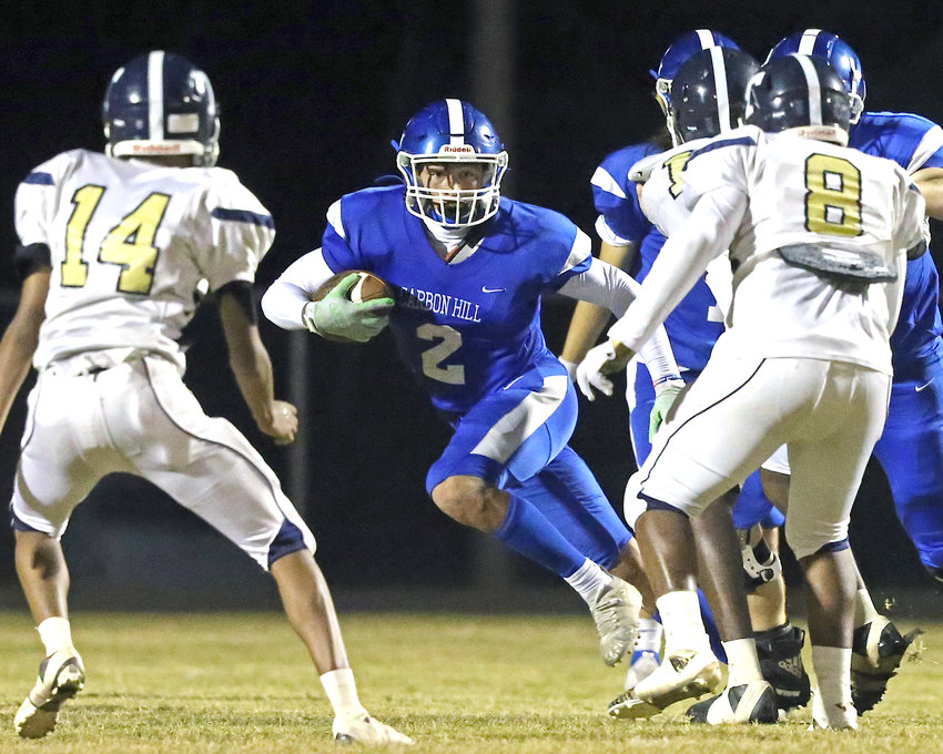 Carbon Hill's Devon Daniel looks for running room against Tarrant on Friday night at G.W. Keith Stadium. Daniel rushed for 245 yards and three touchdown on eight carries and also caught two passes for 49 yards and two scores in the 53-8 win.