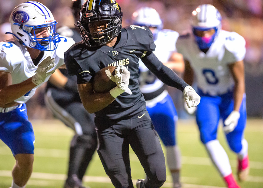 Jasper's Treyvon Stewart (7) runs against Mortimer Jordan on Friday night. Stewart rushed for 280 yards and three touchdowns in the Vikings' 54-38 victory.