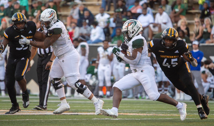 Southern Miss Golden Eagles defensive lineman Josh Carr Jr. (45) tracks down UAB Blazers running back A.J. Gates (23) during the fourth quarter of their game in Hattiesburg, Miss., on Saturday.
