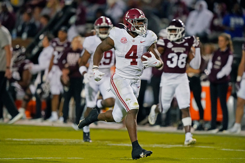 Alabama running back Brian Robinson Jr. (4) runs for a first down while Mississippi State safety Jay Jimison (36) pursues during the second half of their game in Starkville, Miss., on Saturday.