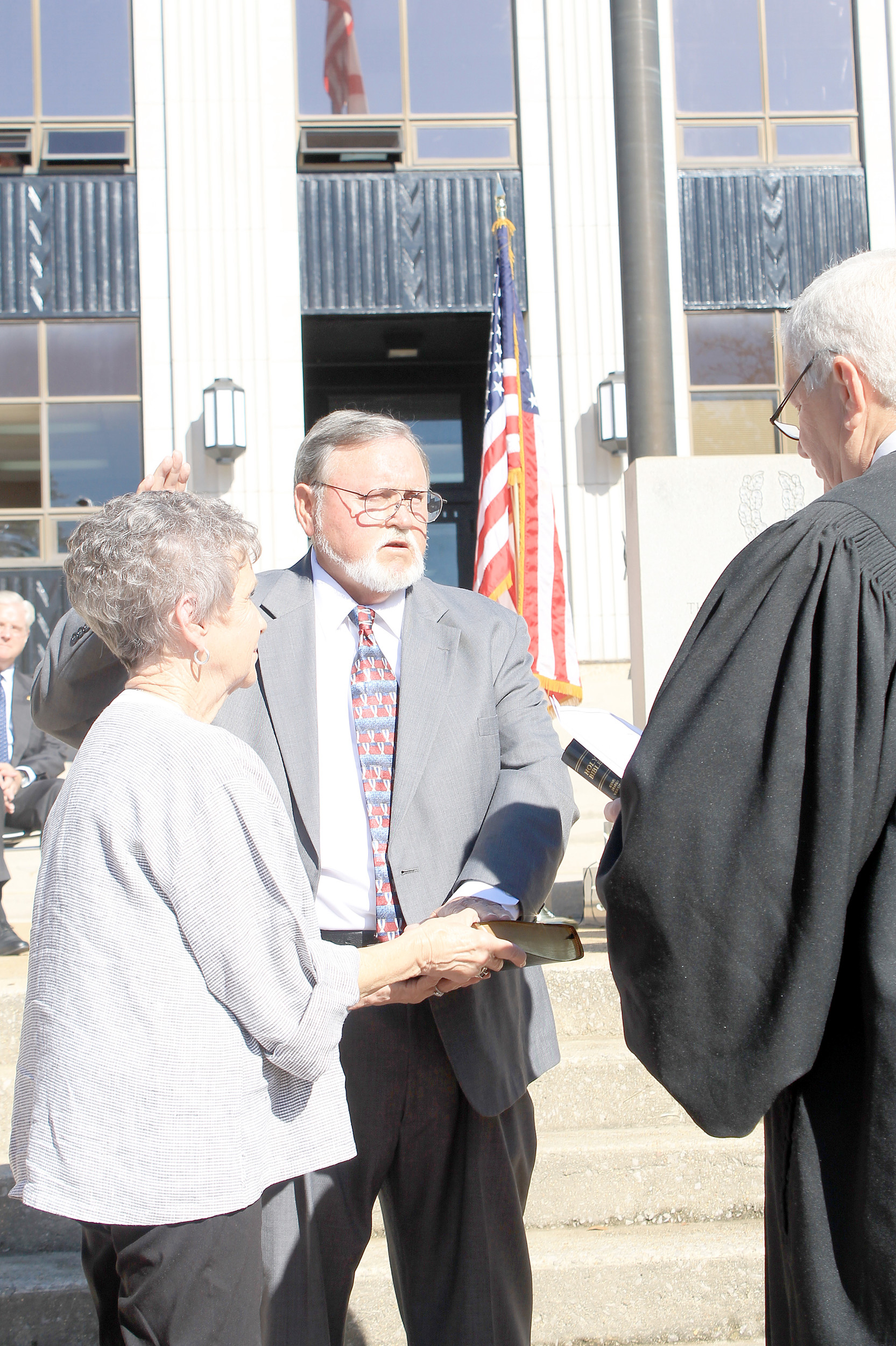 Jerry Bishop takes the oath of office as he is sworn in Wednesday morning as the new chairman of the Walker County Commission. The ceremony was held on the courthouse square in downtown Jasper. Daily Mountain Eagle - Jennifer Cohron