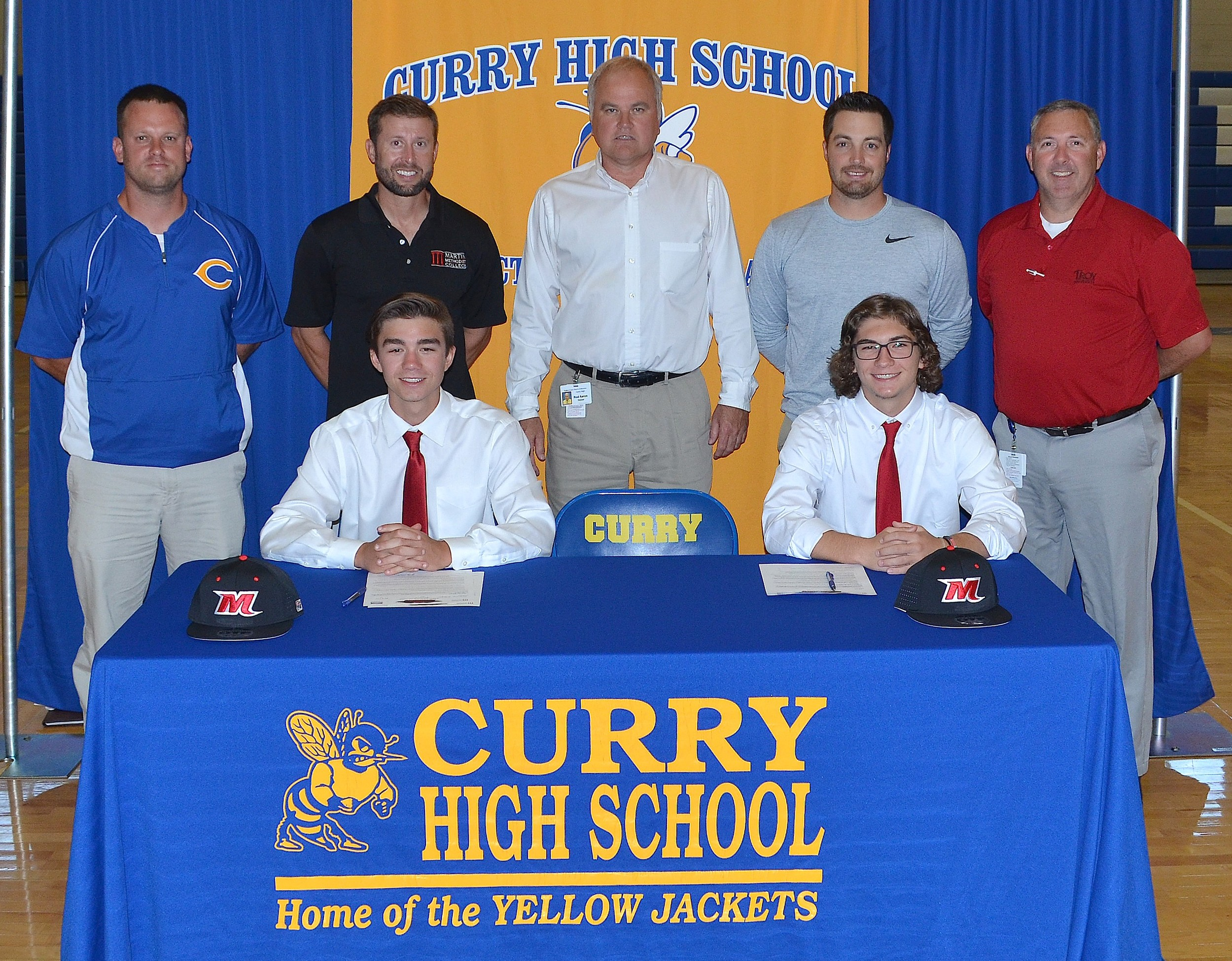 Curry's Mckinlee Gillespie, seated left, and Gage Lynn, right, signed with Martin Methodist College on Tuesday. The two will play baseball for the NAIA school located in Pulaski, Tenn.