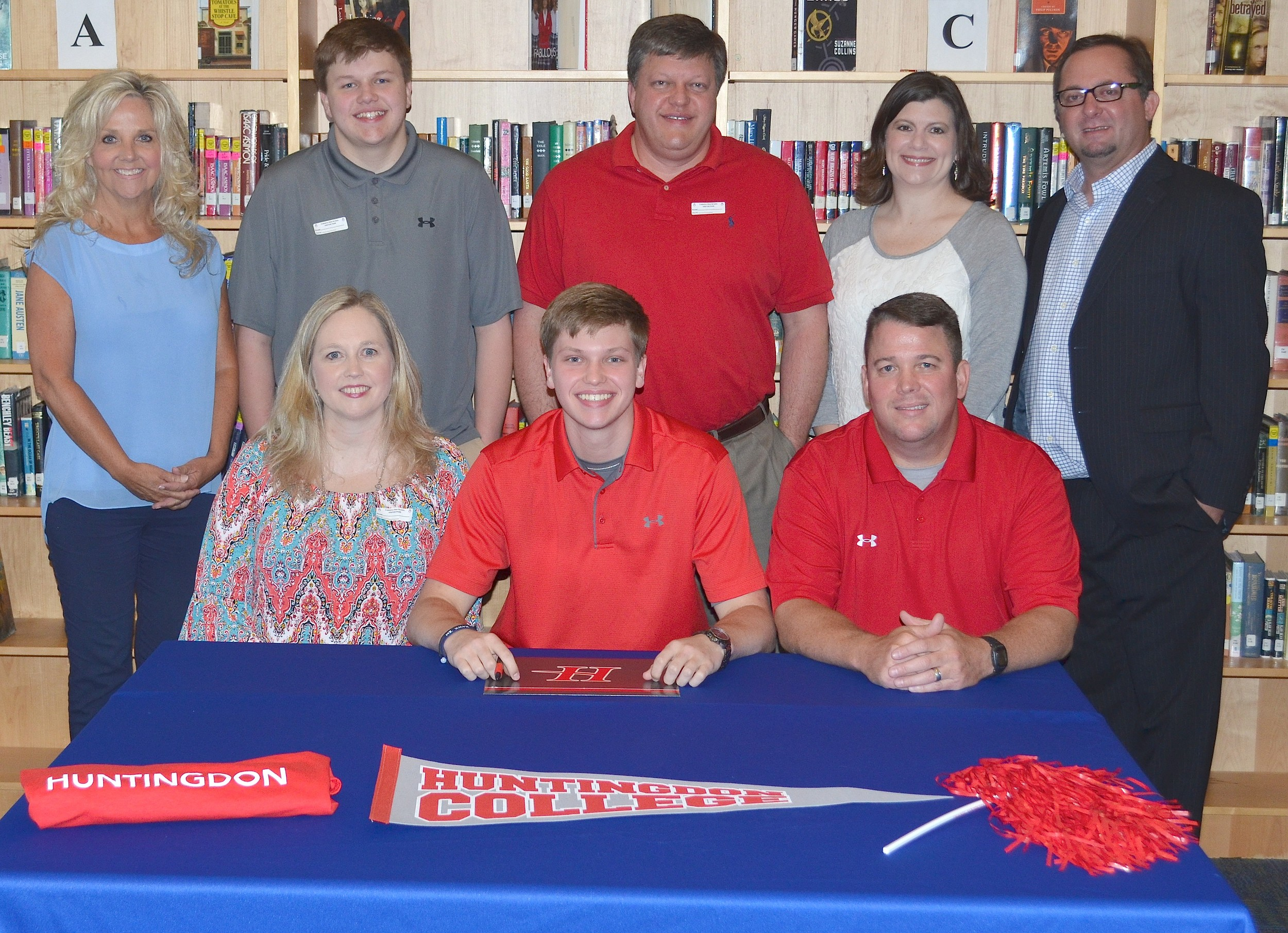 Cordova's Graham Martin signed with Huntingdon College last week. He will play basketball at the NAIA school located in Montgomery. Present at the signing were, seated from left, Donna Fleming (mother), Graham Martin and Ken Fleming (step father), back row, Cordova High School Principal Kathy Vintson, Drew Martin (brother), Terrell Martin (father), Stephanie Martin (step mother) and Cordova basketball coach Heath Burns.