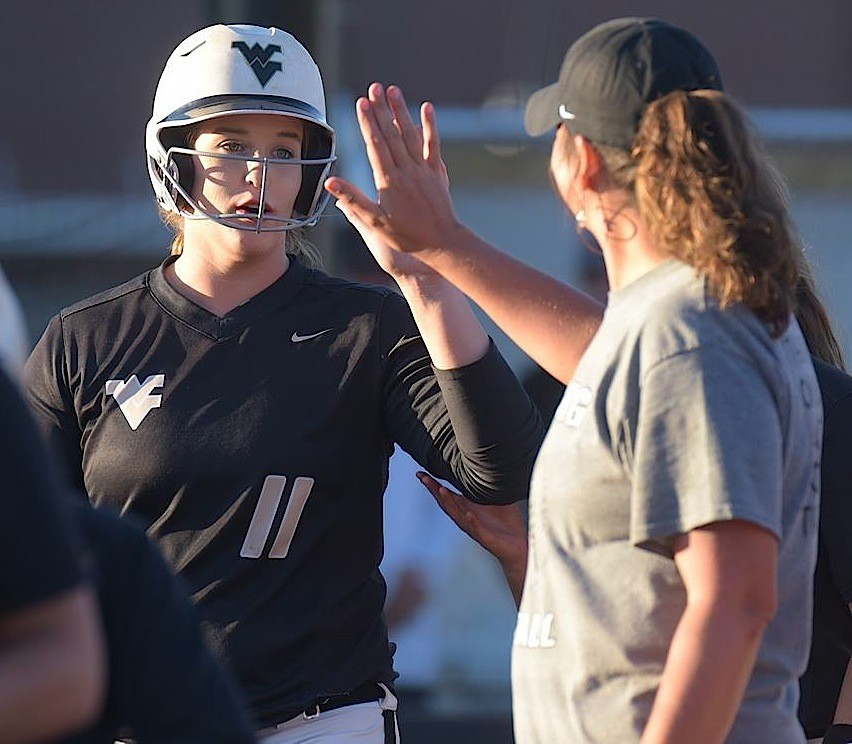 Walker's Skylar Birdyshaw (11) high fives assistant coach Kalah Morrow after scoring a run during a game this season. The Lady Vikings open play in the State Softball Tournament against No. 7 Chelsea at 9 a.m. today at Lagoon Park in Montgomery.
