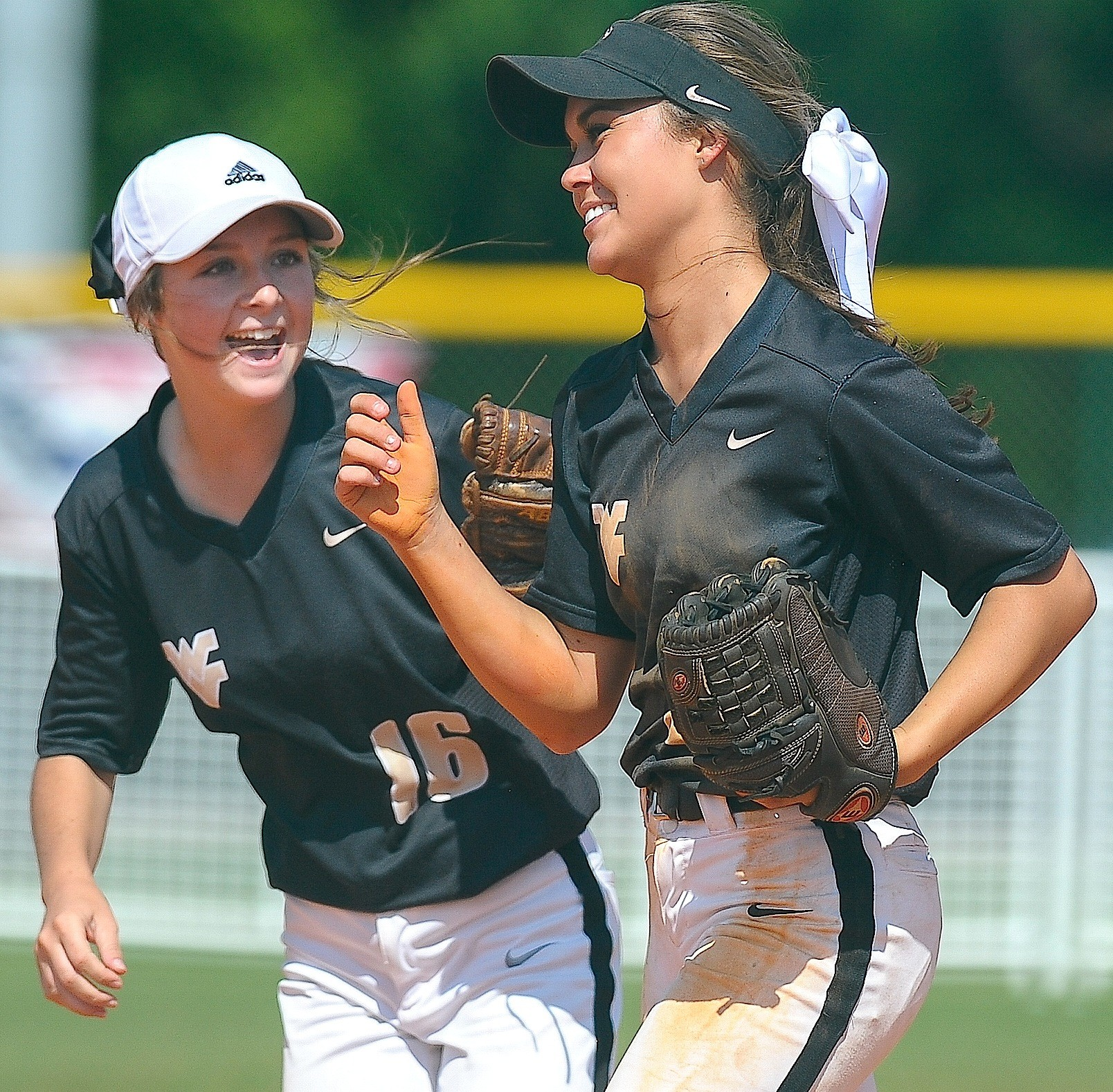 Walker players Maylen Sargent (16) and Abby Trotter, right, celebrate a double play during the Lady Vikings' game against Chelsea at Lagoon Park in Montgomery.
