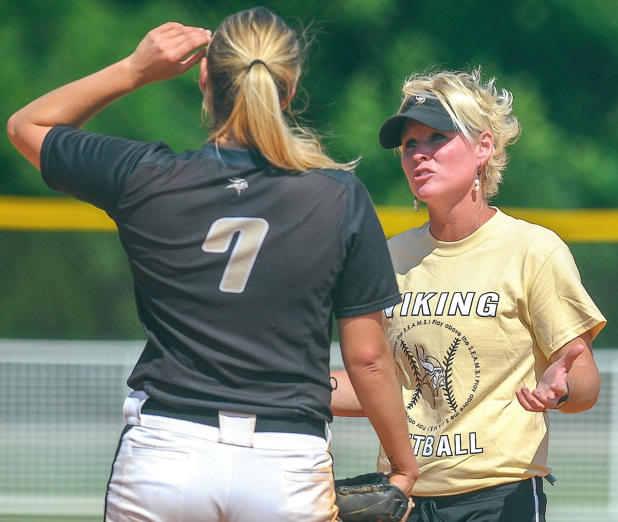 Walker softball coach Brandi Hall, right, talks with pitcher Mabry Norris (7) during their game against Chelsea at the State Softball Tournament in Montgomery on Wednesday. The Lady Vikings were eliminated from the double-elimination tournament, losing to Chelsea (4-3) and Northview (3-2).