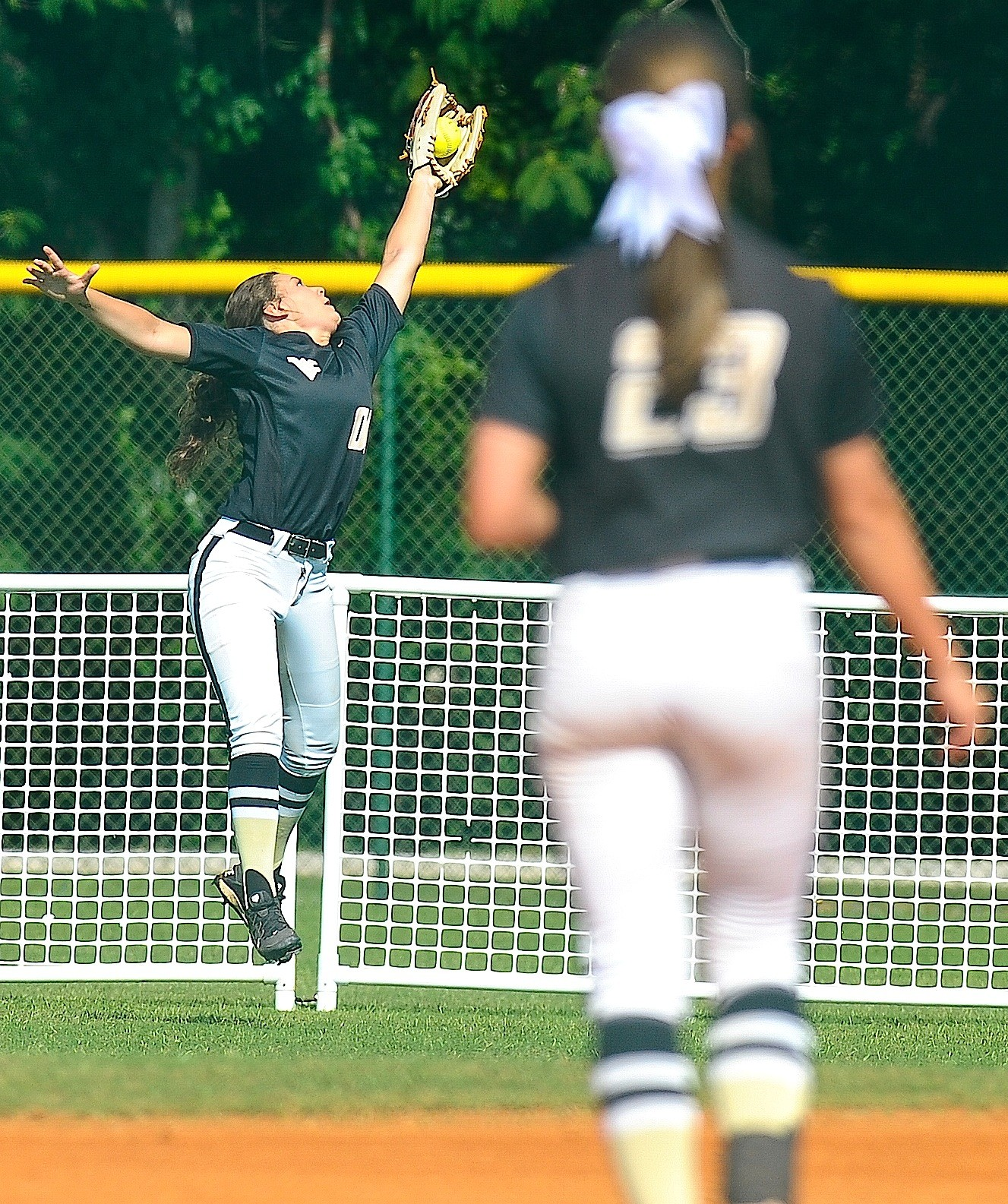 Walker's Khloe Kimbrell makes a leaping catch during the State Softball Tournament on Wednesday. The Lady Vikings dropped their first two games in the double-elimination tournament.
