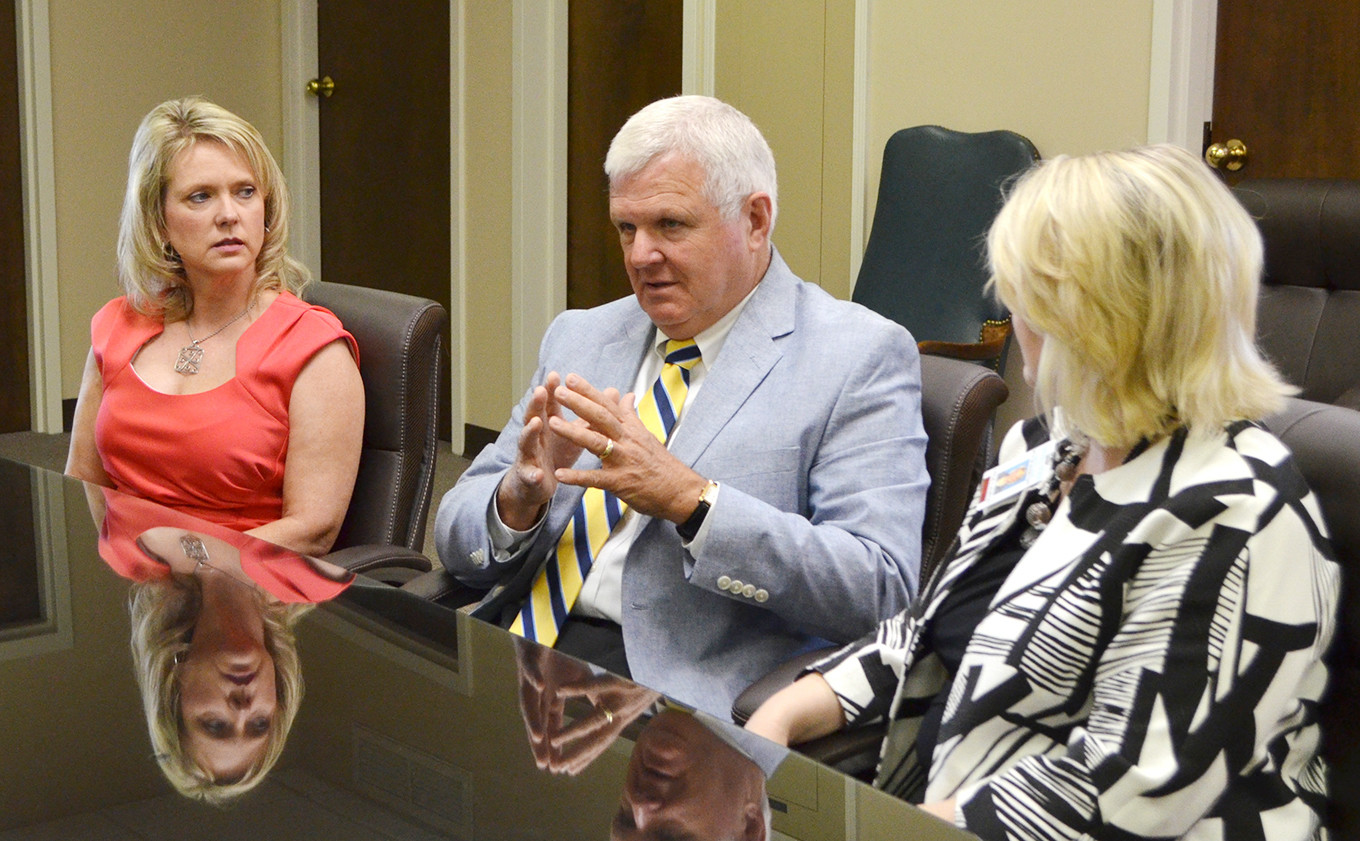 Jasper Mayor David O'Mary, center, discusses how Bevill State Community College's new program will benefit the city of Jasper and Walker County as a whole. Also pictured is  Lisa Killingsworth, treasurer of Jasper Main Street's Board of Directors, left, and Bevill State's Dr. Leslie Cummings, at right.  Daily Mountain Eagle - Nicole Smith
