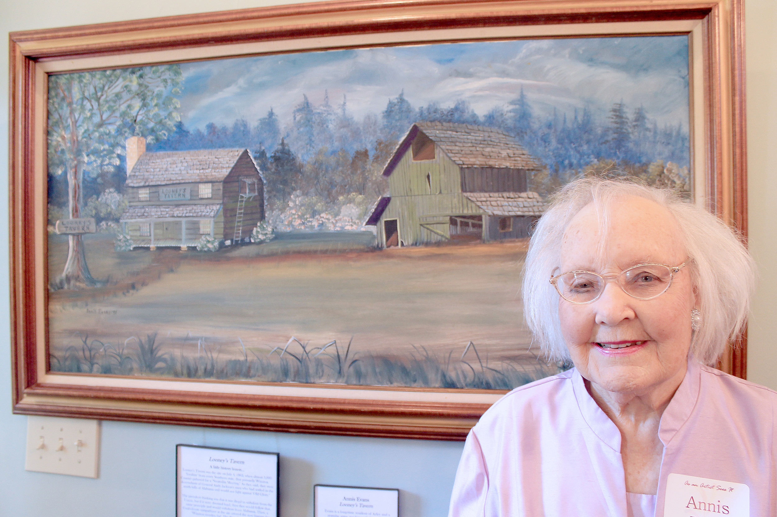 "Annis Evans stands in front of her painting of Looney's Tavern at the Bankhead House and Heritage Center on Tuesday during a reception for ""As an Artist Sees It."" Daily Mountain Eagle photo - Jennifer Cohron"
