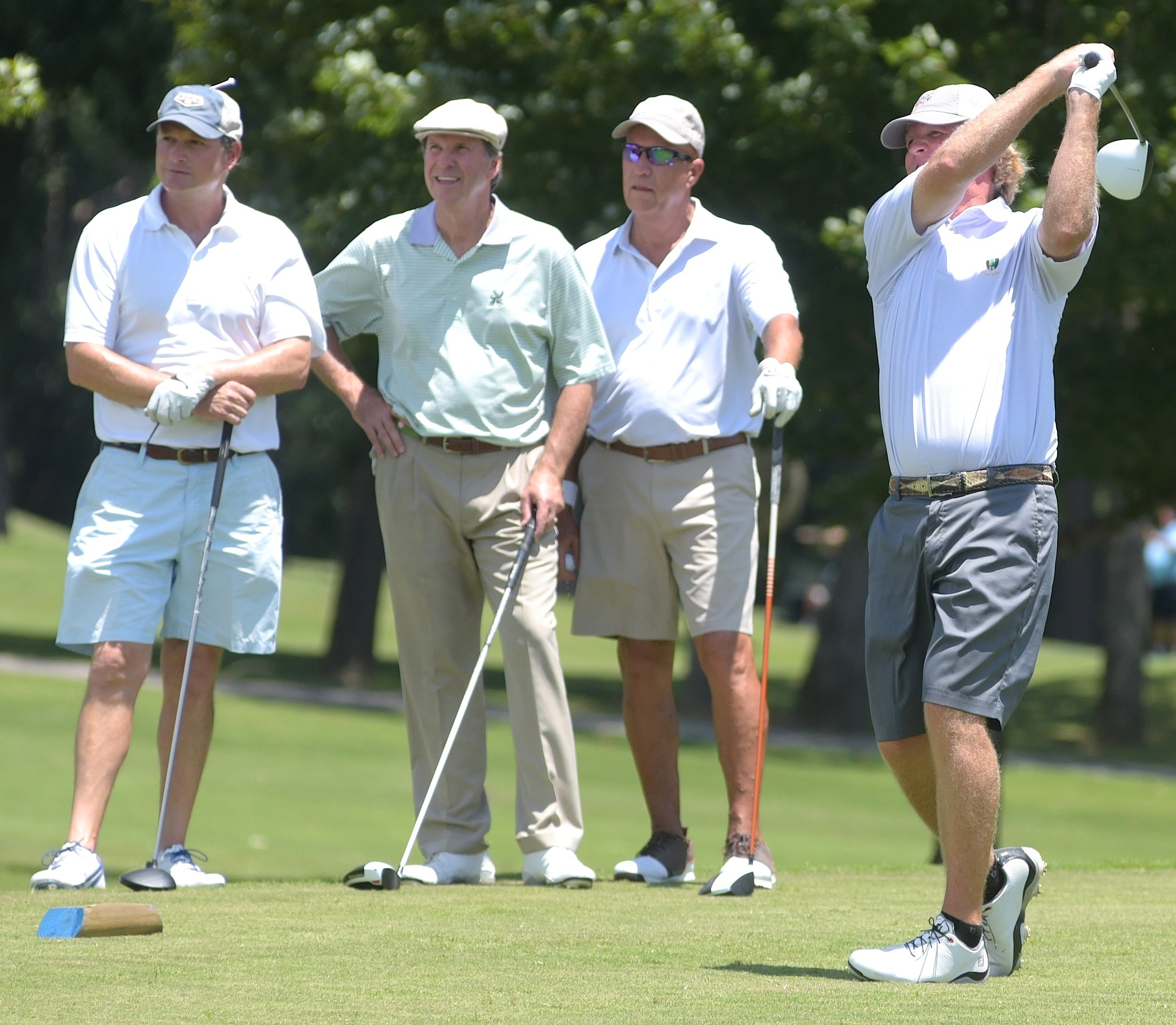 Alan Pope, right, hits a drive on the 16th hole during the opening round of the Travis Hudson/Bernard Weinstein Invitational as, from left, Patrick Drummond, Steve Hudson and Murray Hixson look on. The trio of Cody O'Toole, Eli Marty and Ben Follett are tied for the lead after the first round. The three-day tournament ends on Sunday.