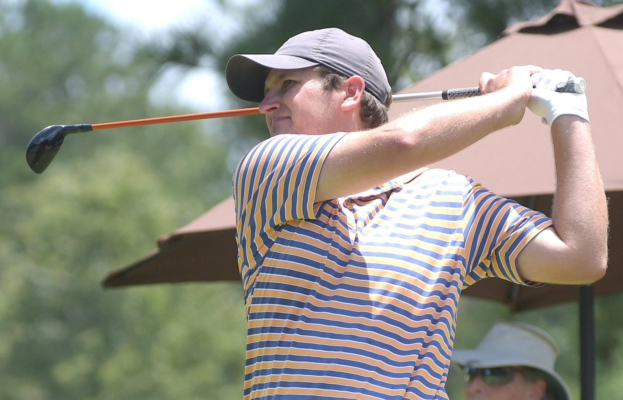 Clay Guerin watches his drive on the first hole during the 50th Annual Travis Hudson/Bernard Weinstein Invitational at Musgrove County Club. Guerin won the tournament with a 199 total.