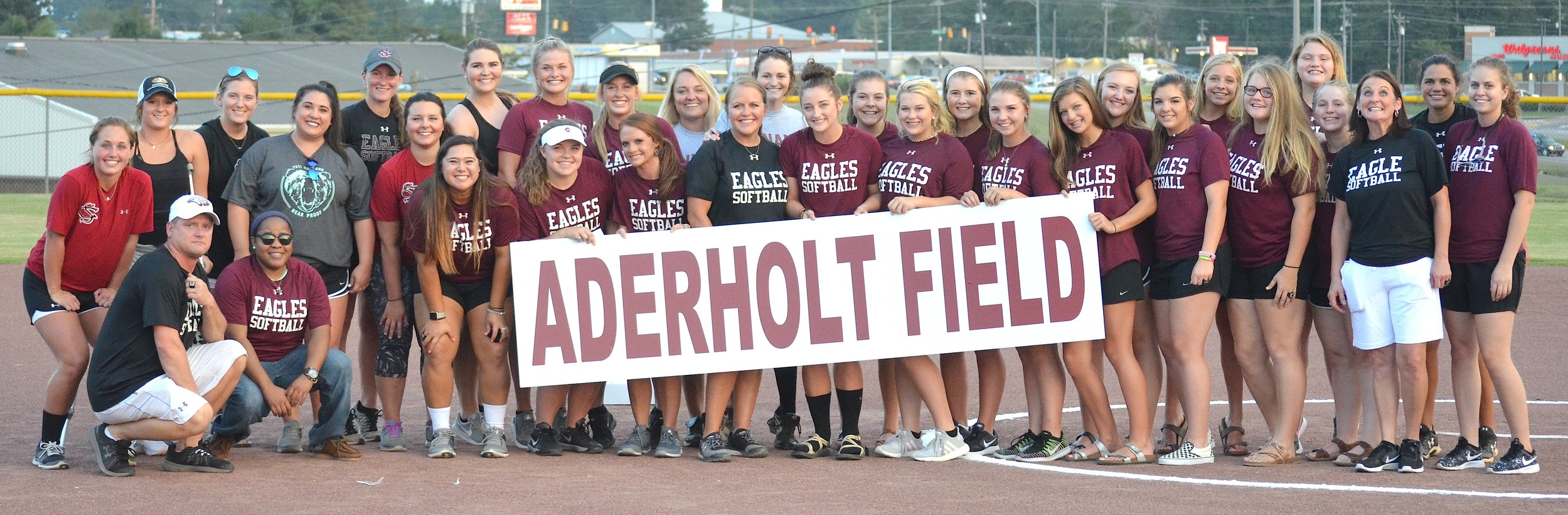Sumiton Christian softball players from the past joined recent players in honoring coach Jessica Aderholt at the school on Thursday. The Eagles' renamed the softball field in Aderholt's honor.