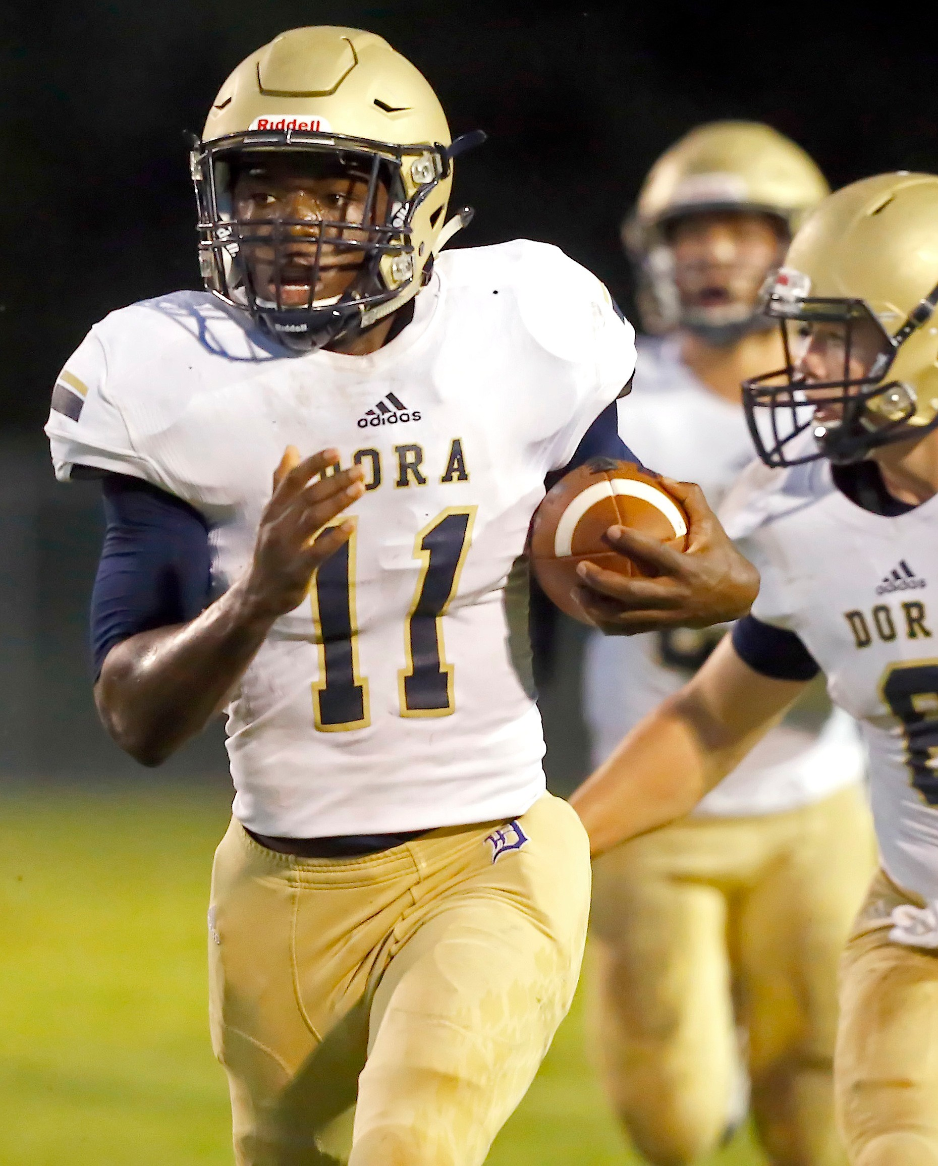 Dora's Achilya Dixon (11) runs for a 79-yard touchdown against Carbon Hill during their game Friday night. Dora won the game 40-6.