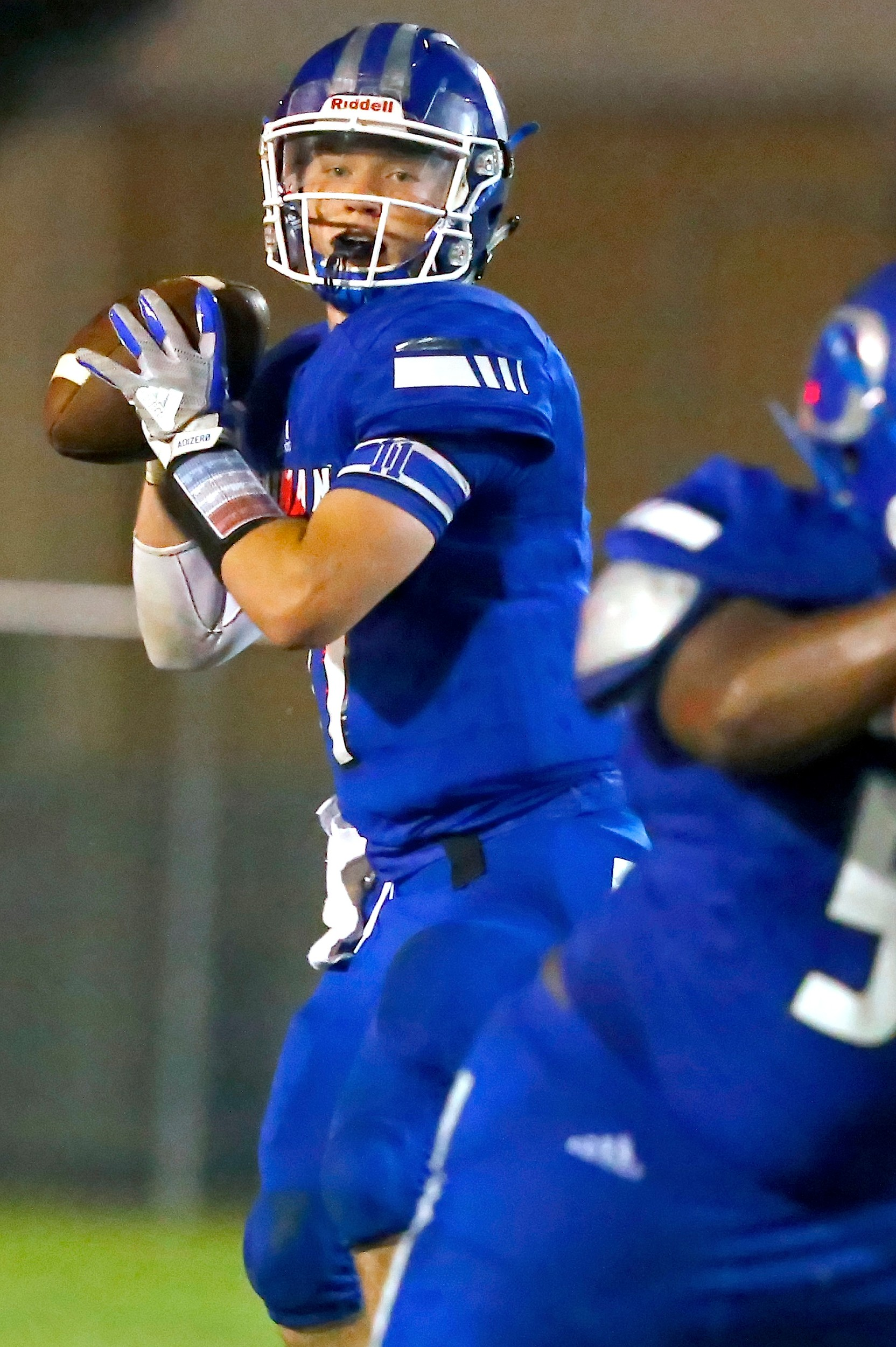 Oakman's Jon Avery throws against Lamar County Friday night. Avery completed 15 of 15 passes on the night for 271 yards and a score. Avery broke the old state record by five passes.