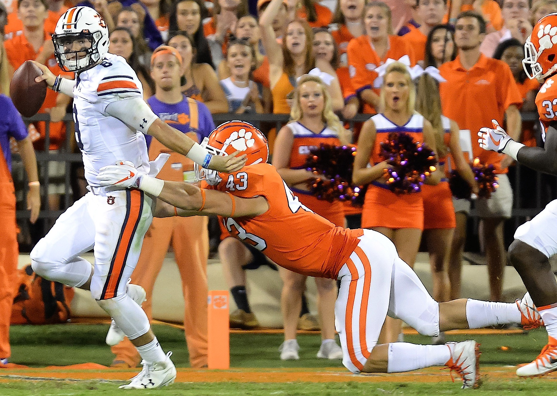 Auburn Tigers quarterback Jarrett Stidham (8) is pressured by Clemson Tigers linebacker Chad Smith (43) during the second half of their game Saturday at Memorial Stadium in Clemson, South Carolina.