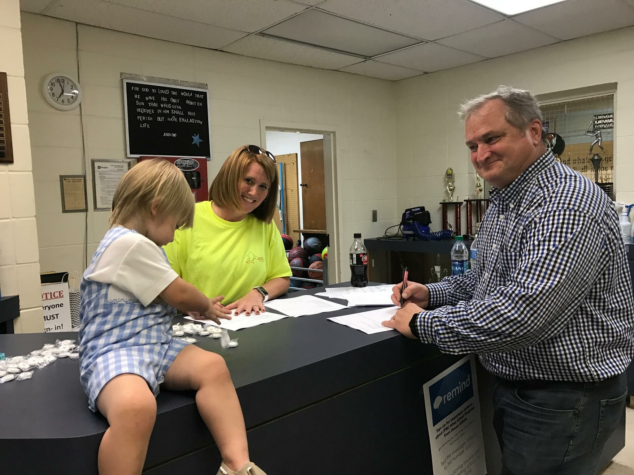 Paul Kennedy, right, was one of several volunteers working to register evacuees Sunday night at Jasper's First Baptist Church.  April Reed - Special to the Eagle