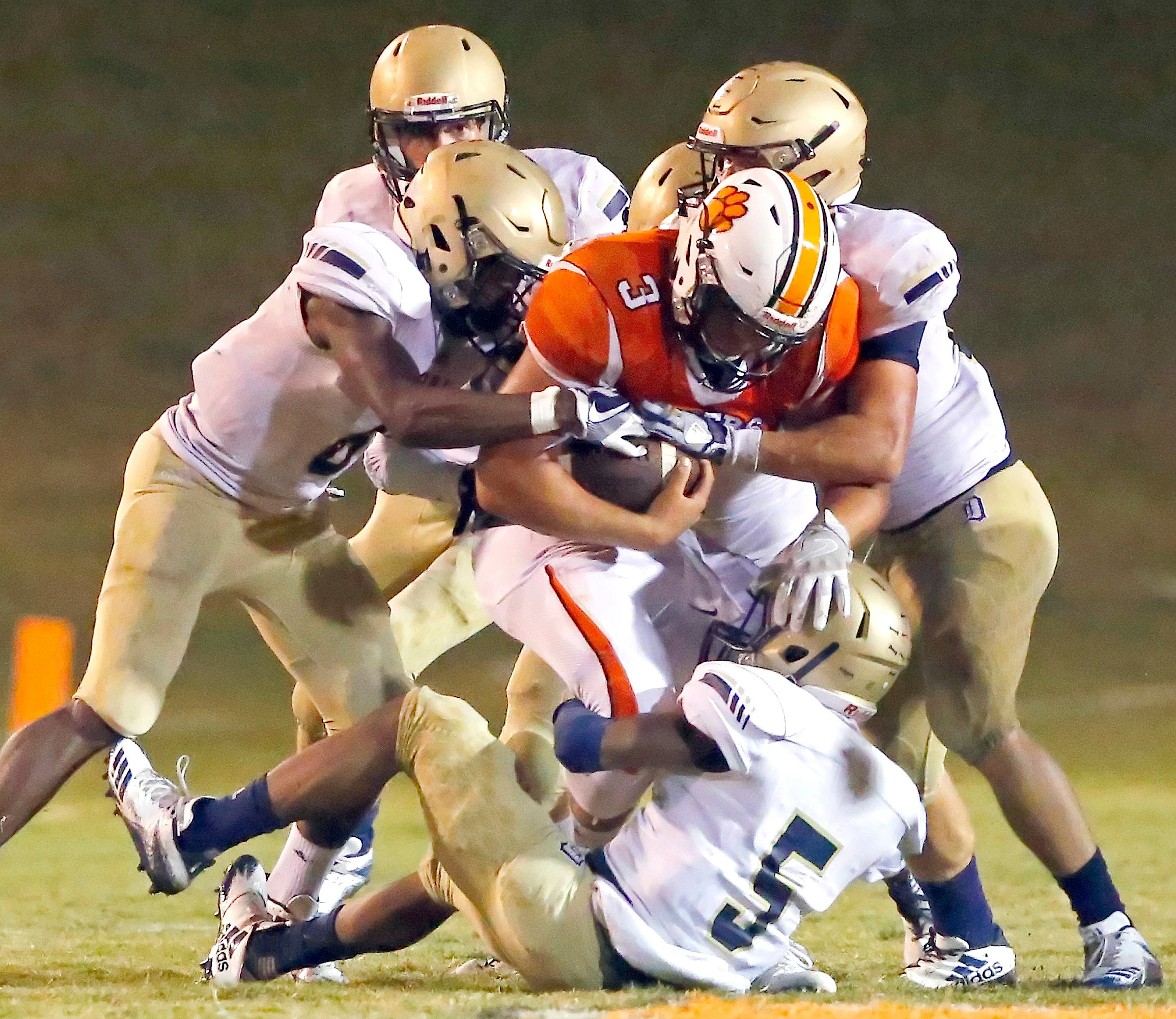 Dora defenders converge on Fayette County Chance Stevenson (3) on Friday night. Fayette County edged Dora 22-20.