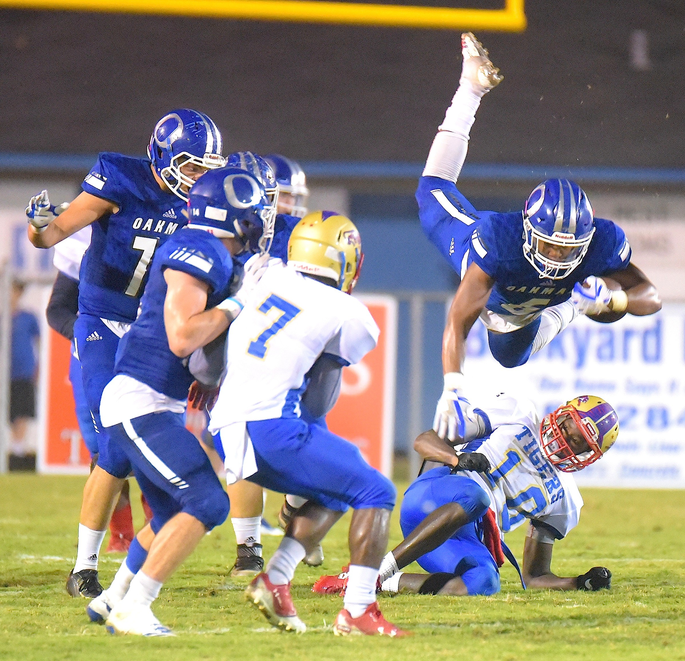 Oakman's Christian Hubbard (6) goes head over heels during the Wildcats' win over Greene County. Oakman moved to 3-0 on the season with a 21-20 victory. Hubbard rushed for 172 yards and a score.