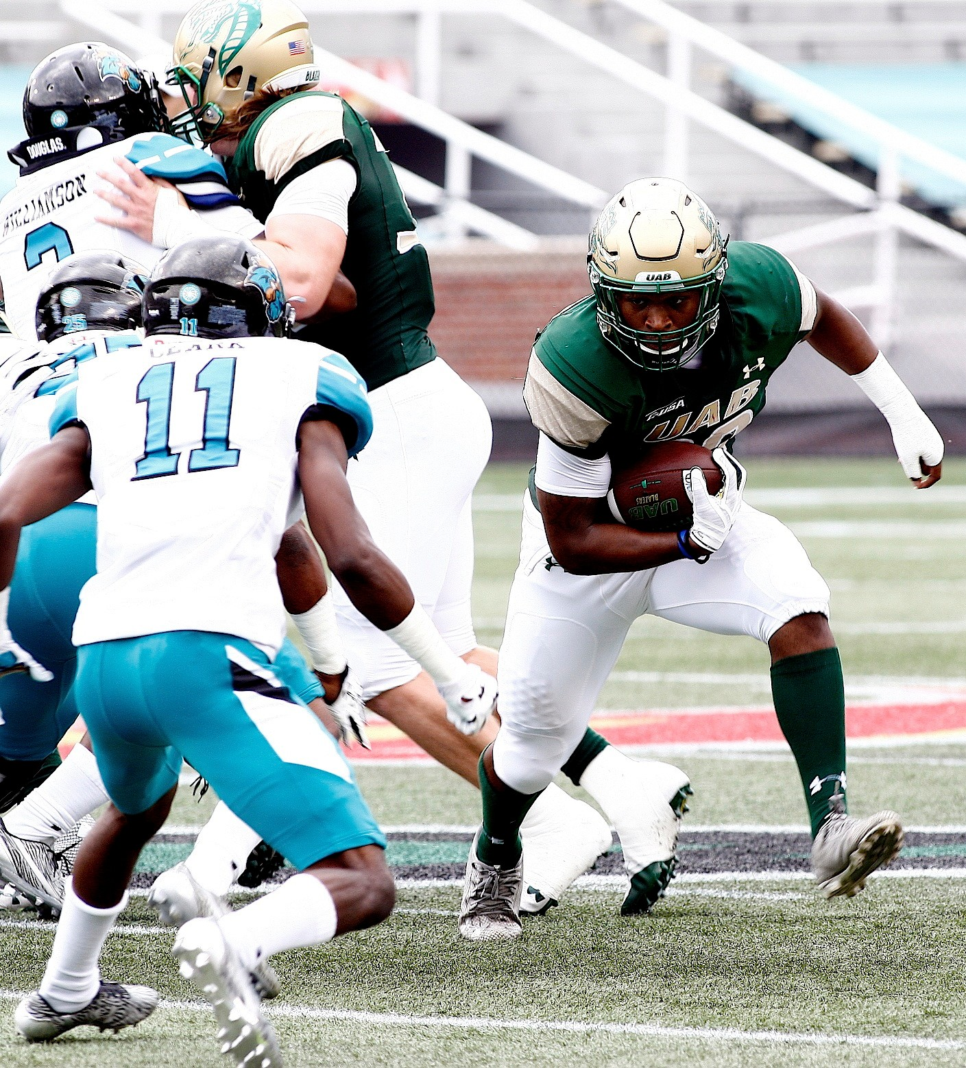 UAB running back Spencer Brown runs against Coastal Carolina during Saturday's game at Legion Field. Brown rushed for two touchdowns in the Blazers' 30-23 win.